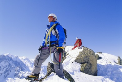 Two mountain climbers standing on snowy mountain